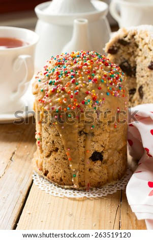 Traditional Easter bread - kulich with raisins and poppy seeds decorated with nonpareil balls
