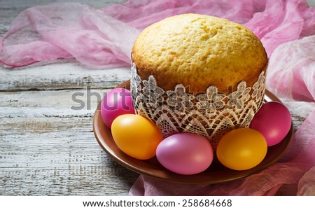 Traditional Easter cake and painted eggs. Selective focus - stock photo