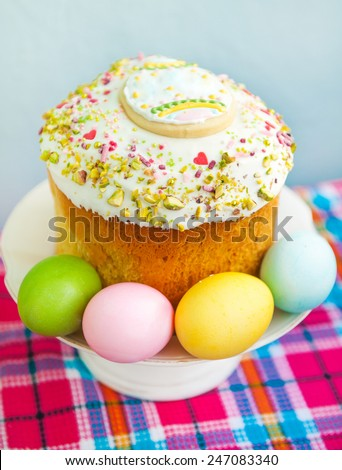 Traditional easter cake with colorful eggs - stock photo