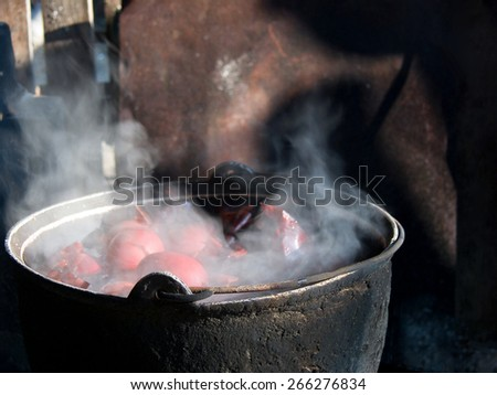 Traditional Easter eggs boiling in a cauldron  - stock photo