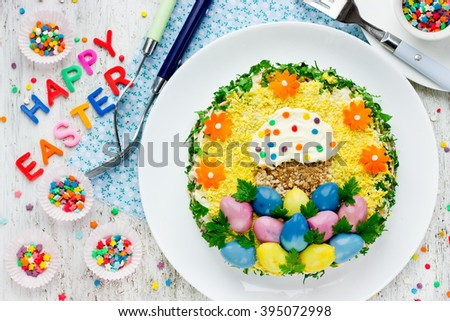 Traditional Easter salad beautifully and colorful decorated Easter symbols. Happy Easter food background top view - stock photo