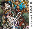 Traditional eastern bright colorful costume jewellery on a street market table. Good for background. - stock photo