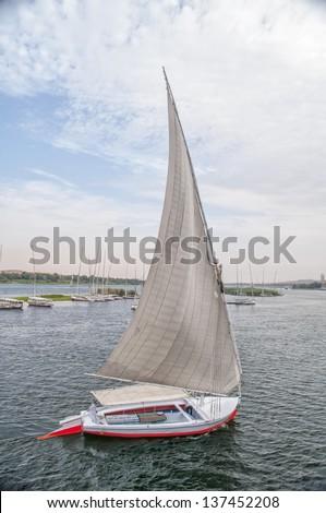 Traditional egyptian feluka on the Nile - stock photo