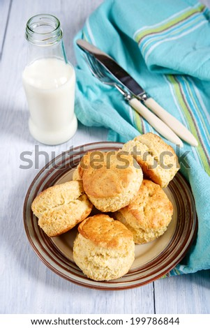 Traditional English baking - scones with milk - stock photo