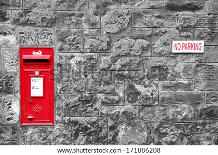 Traditional english red postbox mounted on a wall in St Andrews, Scotland. UK. - stock photo