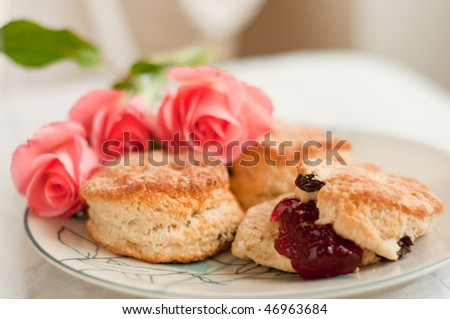 Traditional english scones with jam on the plate - stock photo
