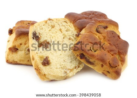 traditional english scones with raisins and a cut one on a white background - stock photo