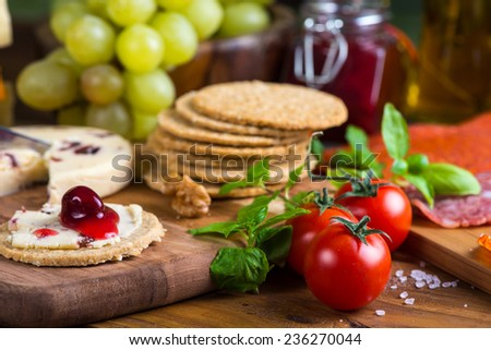 traditional english soft cheese with cranberry sauce - stock photo