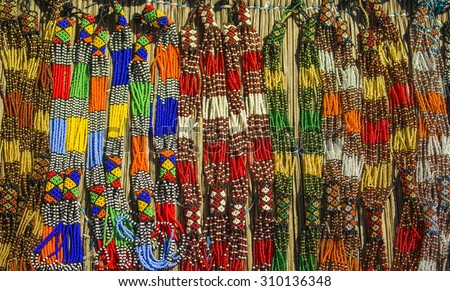Traditional ethnic african handmade colorful beads necklace. Unique craftsmanship. Local craft market in South Africa. - stock photo