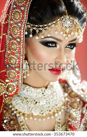 Traditional ethnic bride in costume with heavy jewellery