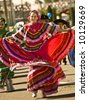 Traditional Ethnic Dancer in the Parada Del Sol (called world's largest horse drawn parade) held in February in Scottsdale Arizona. - stock photo