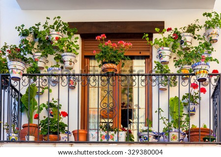 Traditional European Balcony with colorful flowers and flowerpots - stock photo