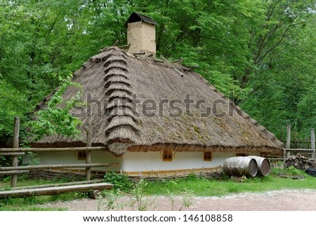 Traditional farmer's house under the thatch roof in open air museum, Kiev, Ukraine