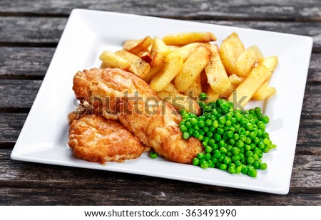 Traditional Fish and chips with peas. - stock photo