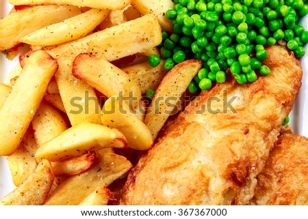 Traditional Fish and chips with peas - stock photo