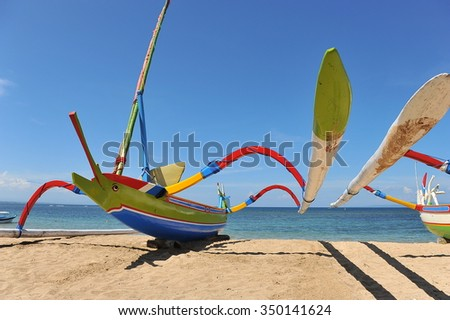 Traditional Fish Boat At Beautiful Sanur Beach, Bali, Indonesia - stock photo