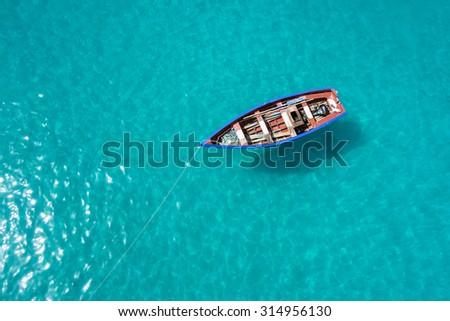 Traditional fisher boat in Santa Maria  in Sal Island in Cape Verde - Cabo Verde - stock photo
