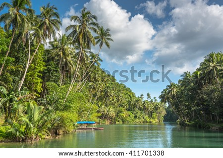 traditional fisherman boat  on a jungle green river Loboc at Bohol island of Philippines - stock photo