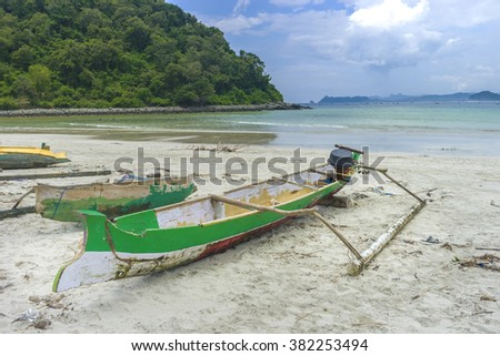 Traditional fisherman wooden boat with cloudy skies at Lombok Selatan, Indonesia - stock photo