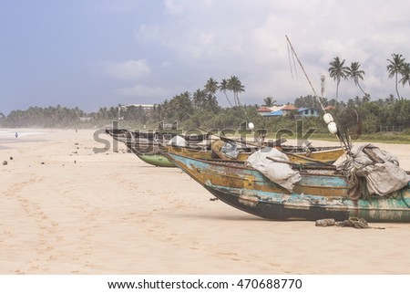 Traditional fishing boat on the beach. Shot in Sri Lanka.