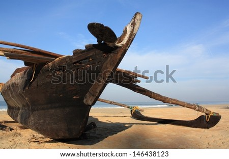 Traditional fishing boat on the Goa beach, India.