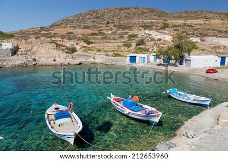 Traditional fishing boats in Ag. Nikolas bay, Kimolos island, Cyclades, Greece - stock photo