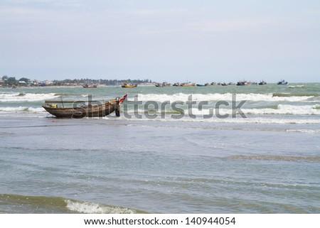 Traditional fishing boats in Mui Ne fishing village, Vietnam - stock photo