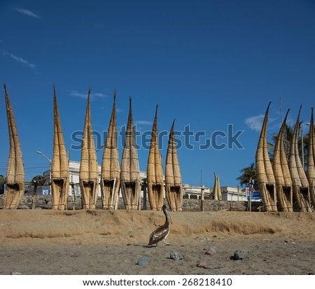 Traditional fishing boats made from reeds on the beach at Huanchaco on the coast of northern Peru - stock photo