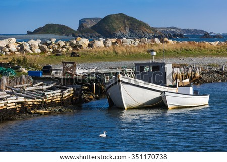 Traditional fishing boats moored in the town of Ferryland, Newfoundland, Canada. - stock photo