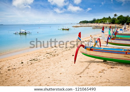 Traditional fishing boats on a beach in Nusa Dua on Bali. Indonesia.
