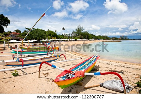 Traditional fishing boats on a beach in Sanur on Bali. Indonesia.