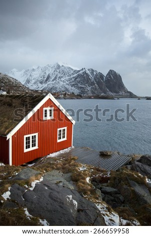 Traditional fishing cabin in Reine, Lofoten, Norway - stock photo