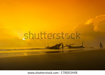 traditional fishing work via great sunset - stock photo