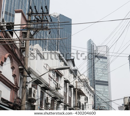 Traditional flat residential building with Shanghai tower Lujiazui, Pudong, Shanghai. - stock photo
