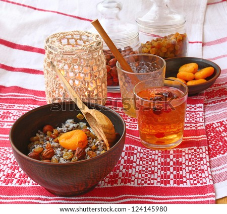 """Traditional food in eve Christmas """"Kutya"""" with a fruit compote on a background a lantern and ingredients - stock photo"""