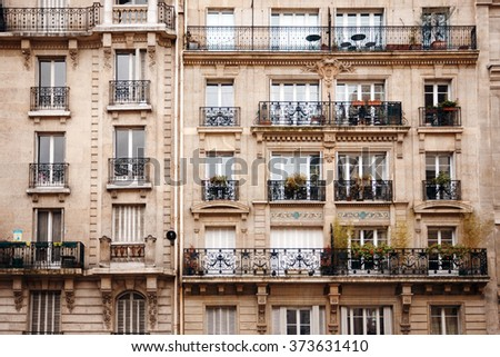 Traditional French Architecture with Typical Windows and Balconies in Paris, France. Haussmann's renovation of Paris Houses. - stock photo