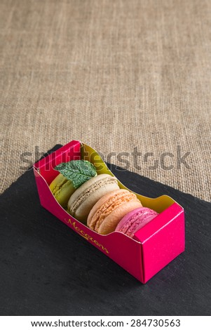 traditional french colorfu beautifull macarons in a rows in a box