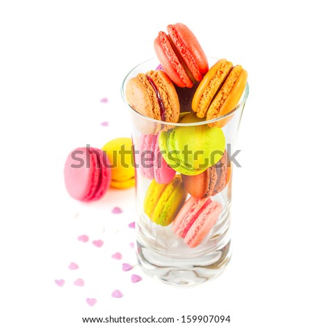 traditional french colorful macarons in a glass on white background - stock photo