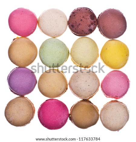 traditional french colorful macaroons on an isolated white background - stock photo