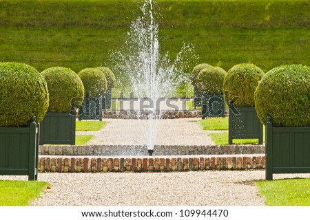 Traditional french garden. Water Garden. Chateau de Villandry is a castle-palace located in Villandry, in department of Indre-et-Loire, France. He is a world known for its amazing gardens. - stock photo