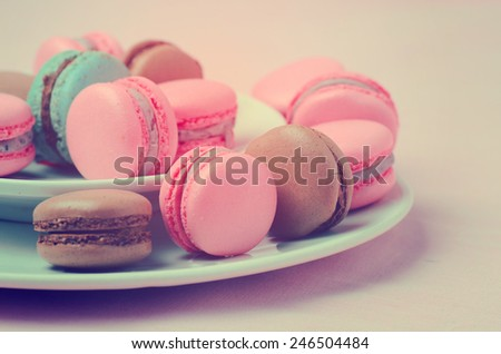 traditional french macarons with retro vintage filter - stock photo