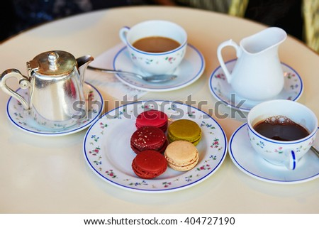 Traditional French macaroons, coffee and hot chocolate in Parisian restaurant - stock photo