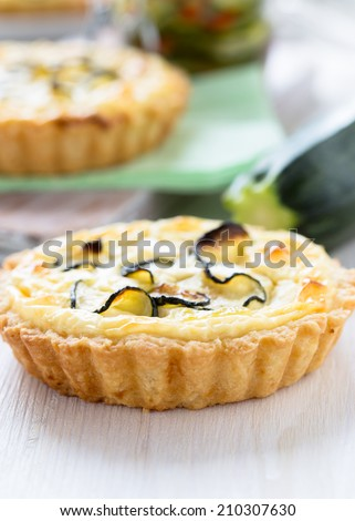 Traditional french quiche, tart with cheese and sliced small zucchini - stock photo