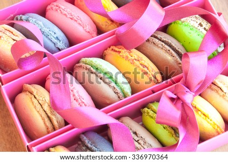 Traditional french sweets macarons in a pink box
