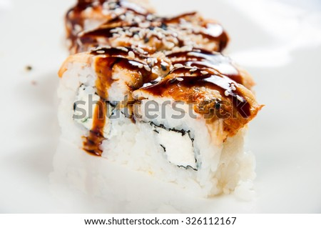 traditional fresh japanese sushi rolls on a white background.