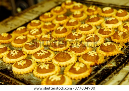 traditional freshly baked pineapple tarts on caramalized tray on display at the heritage city of malacca, normally ate during chinese lunar new year or other festivities and celebration