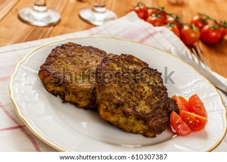 Traditional fried potato pancake on white plate