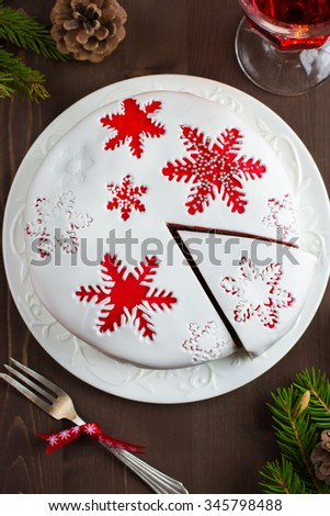 Traditional fruitcake on  Christmas table , top view