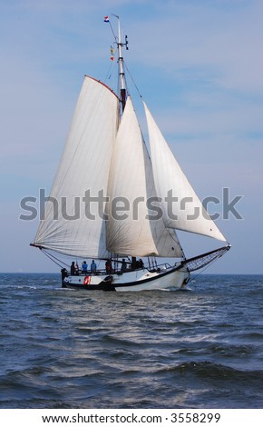 Traditional gaffrigged dutch sailing yacht on the waddenzee - stock photo