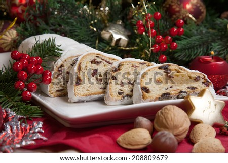Traditional German Christmas Cake   Cranberry Stollen, Christmas Tree,  Ornaments, And Candles.